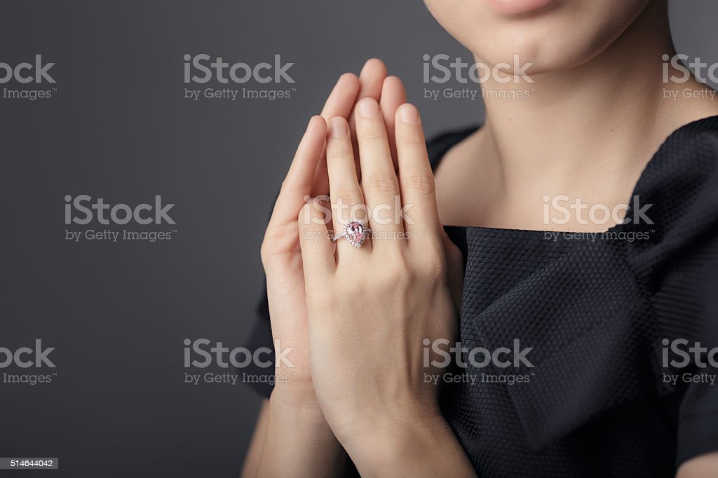 Close up Detail of a Ring on a Female Hand Model stock photo