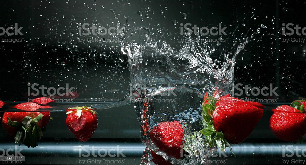 Close Up Detail of Water Splashes and Strawberries stock photo