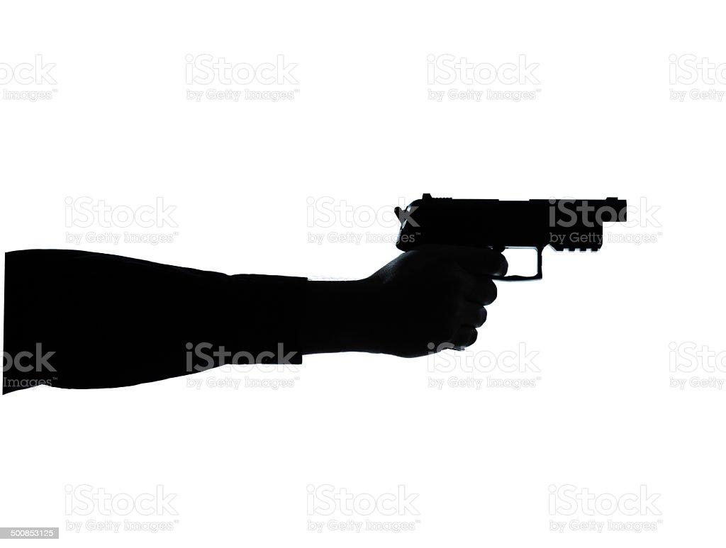 close up detail one man hand aiming gun silhouette stock photo
