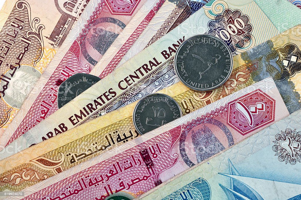 Close up different Dirhams currency note and coins, UAE stock photo