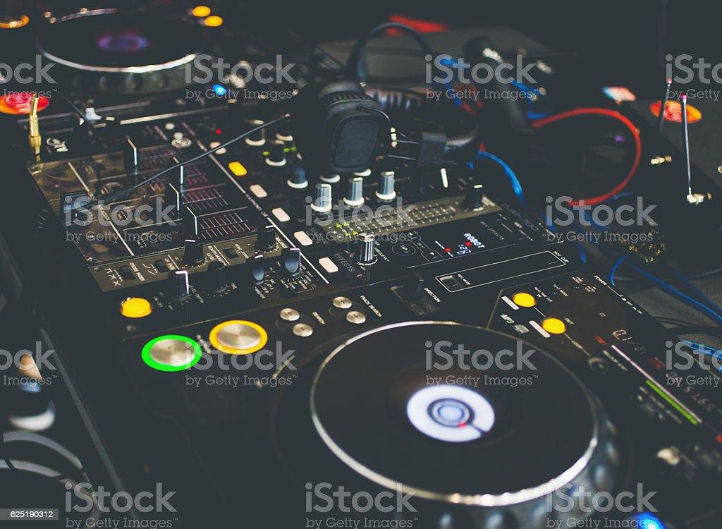 Close up DJ console with DJ headphones stock photo