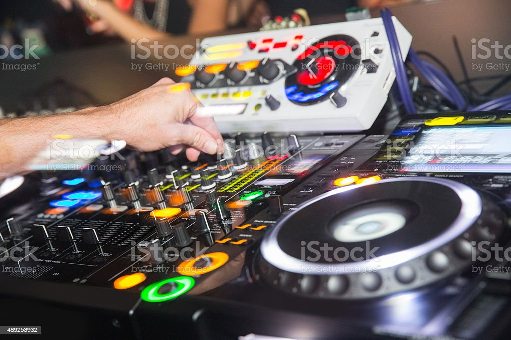 Close up dj hand spinning records stock photo