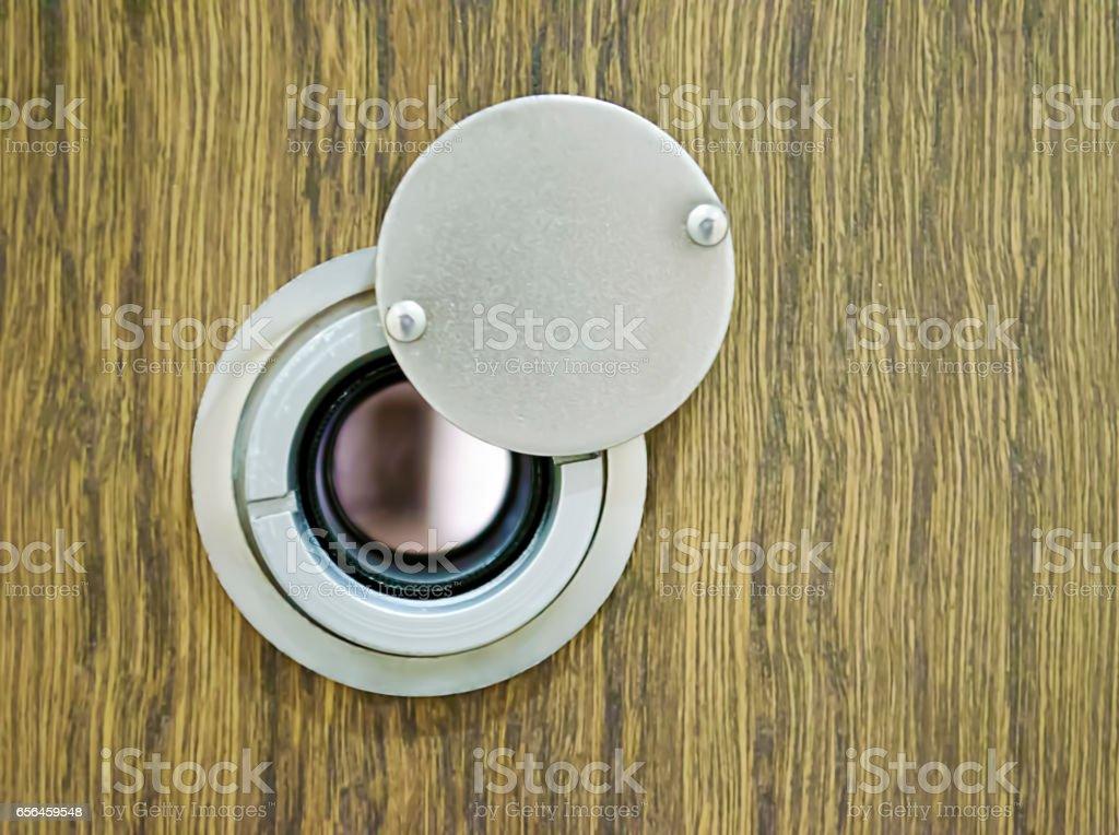 close up door eye on the wooden door stock photo