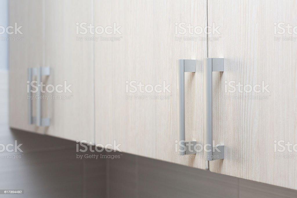 Close Up door handles in kitchen stock photo