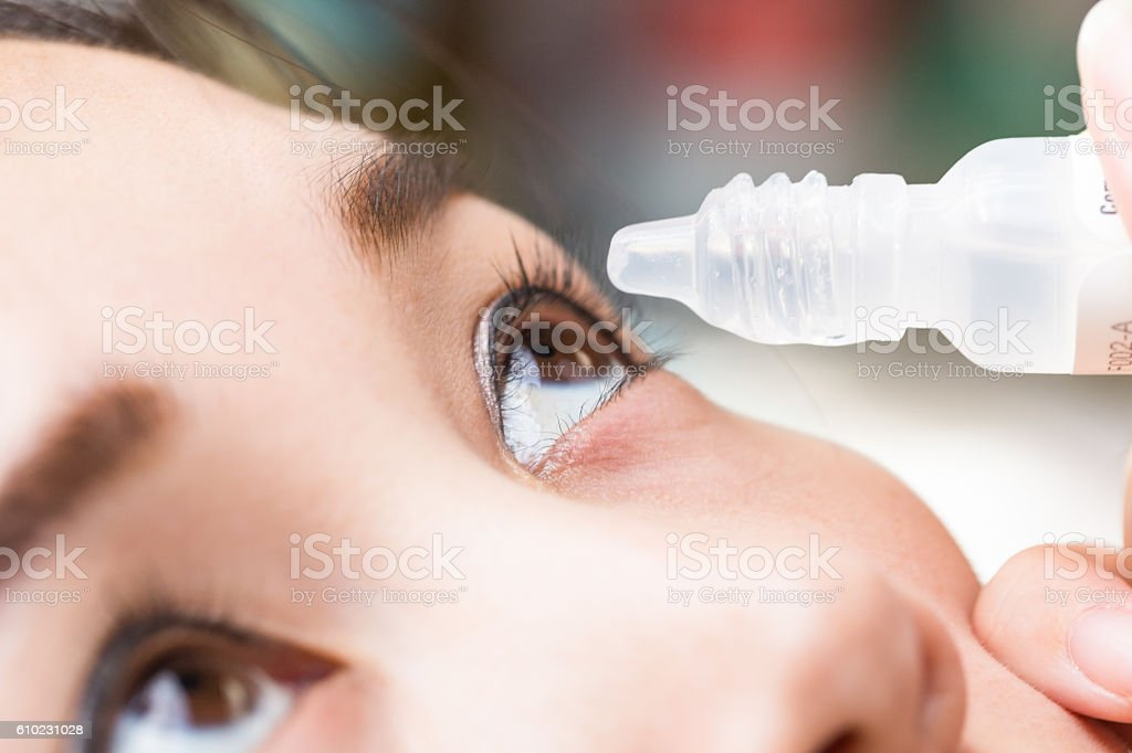 Close up drips into eye cataract medication. stock photo