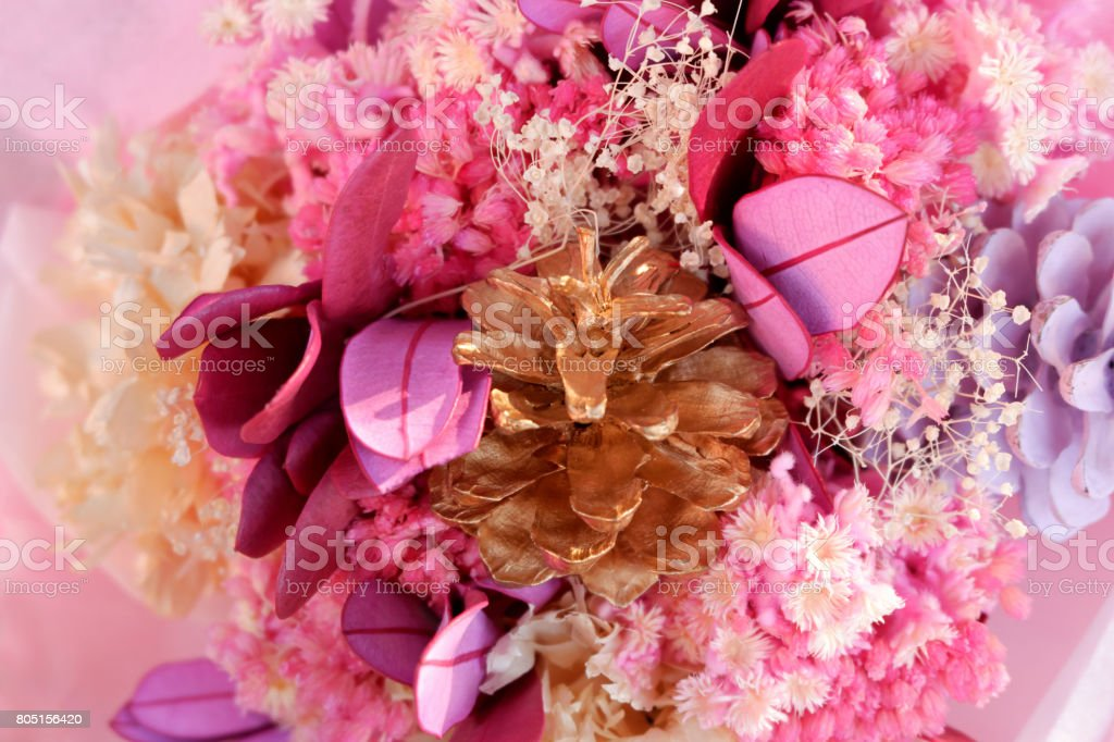 Close up dyed flowers bouquet, pink tone stock photo