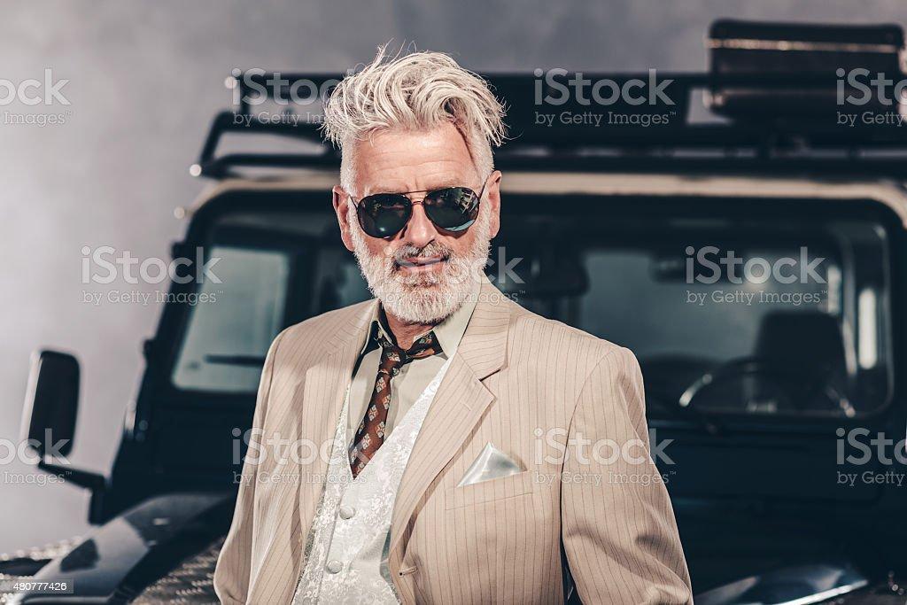 Close up Elegant Senior Blond Guy with Sunglasses stock photo