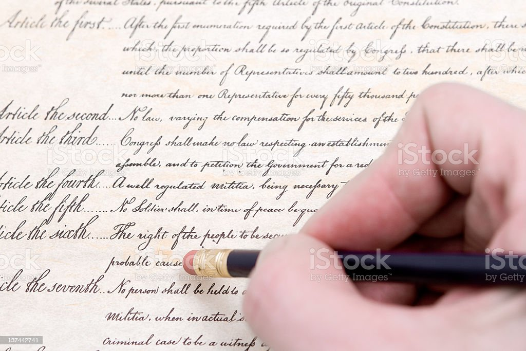 Close up Erasing the fourth amendment to U.S. Consititution stock photo