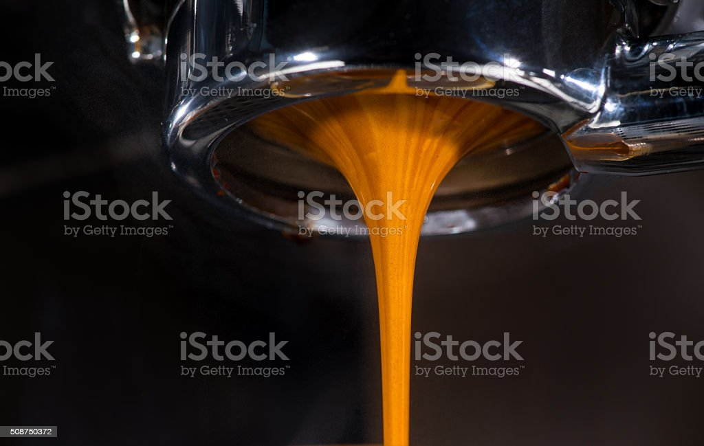 Close up -Espresso Shot from Bottomless Portafilter stock photo