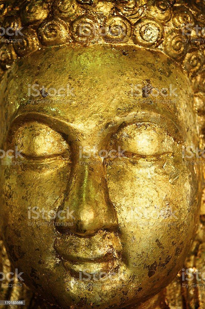Close Up Eyes Closed Gold Leaf Buddha Face royalty-free stock photo