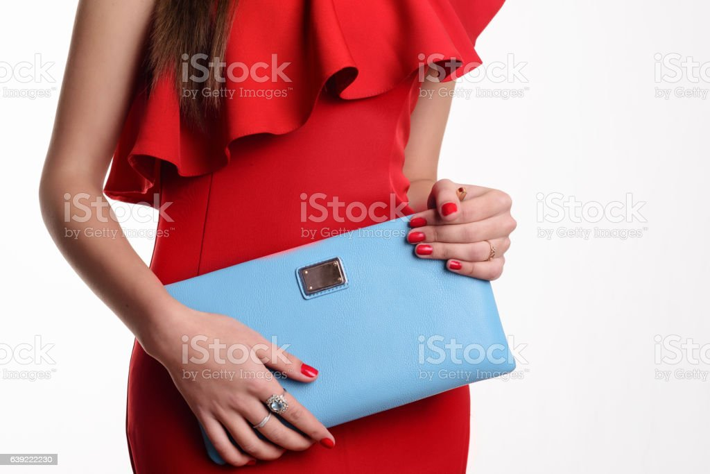 Close up fashion woman in red dress with blue handbag stock photo