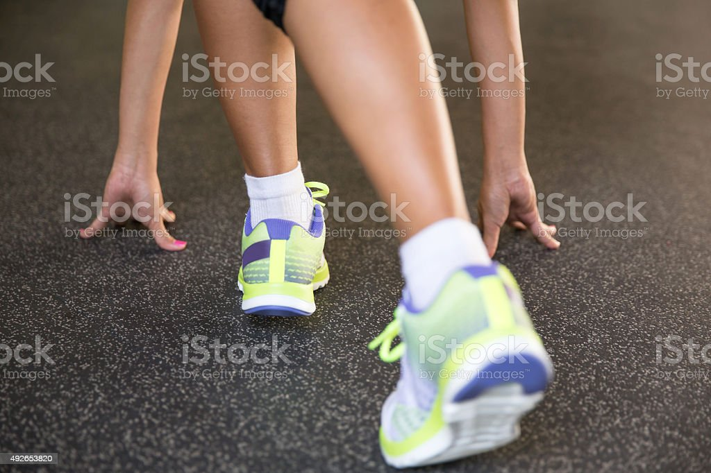 Close up feet of young woman preparing to run stock photo