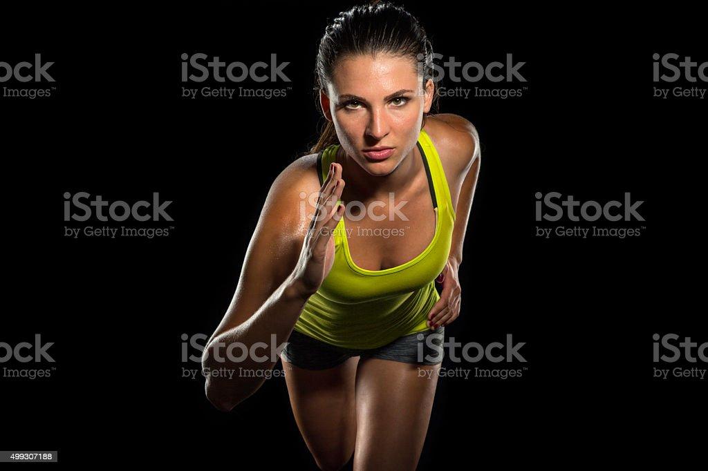 Close up female jogger sprint runner determined athlete training fitness stock photo