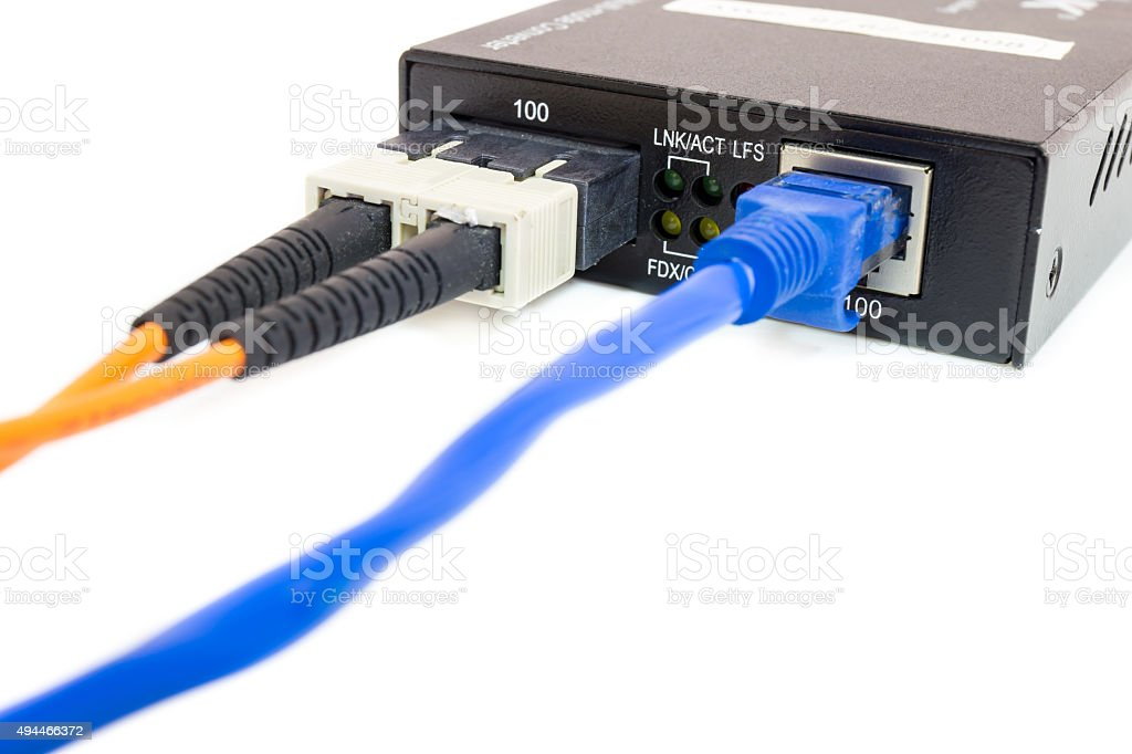 Close up fiber media converter and cables stock photo
