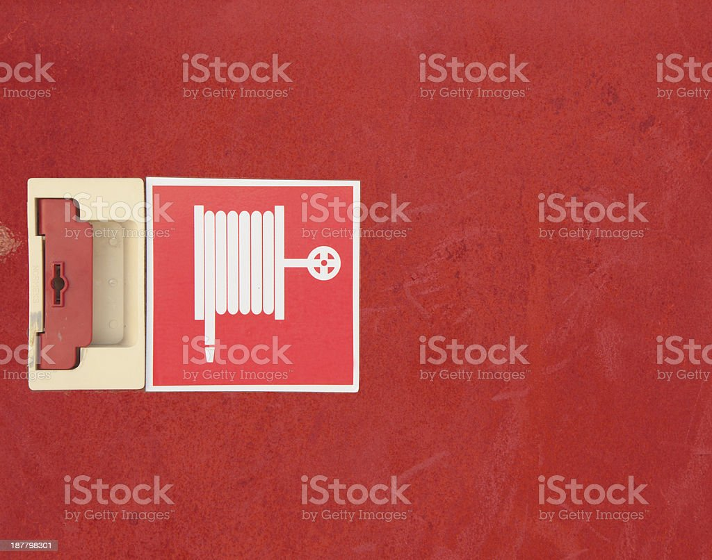 close up fire hose cabinet door and lock stock photo