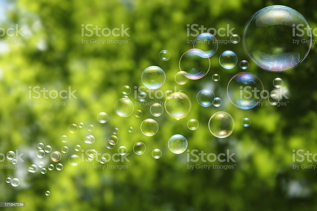 Close up Floating Bubbles on green background stock photo