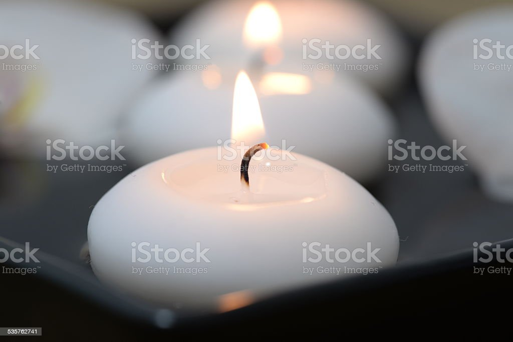Close up floating candle stock photo