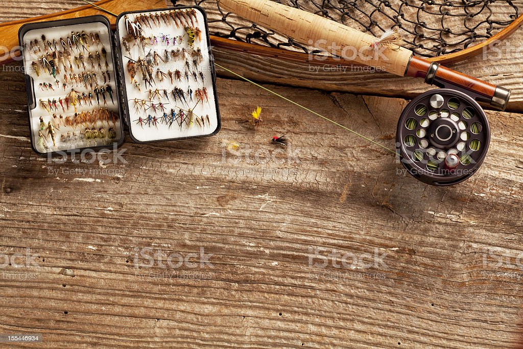 Close up, Fly-Fishing rod & collection of Flies, Copy Space. stock photo