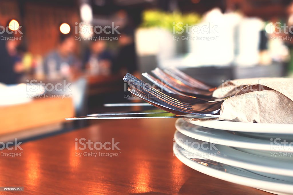 Close up fork and knife on dish in restaurant. stock photo