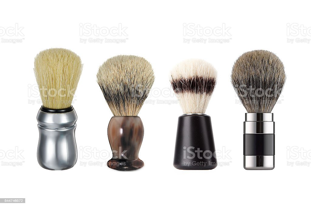 Close up four different shaving brushes isolated stock photo