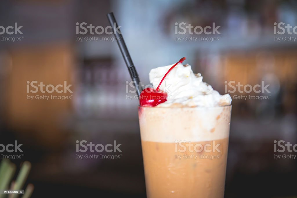 Close up frappuccino with cream and cherry on top stock photo