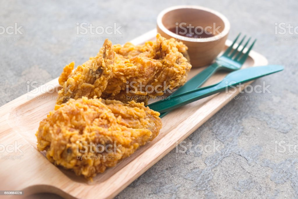 Close up fresh fried chicken on a wooden tray stock photo