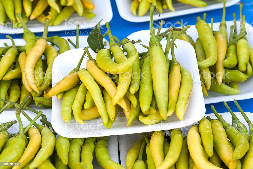 Close up fresh green and yellow chilli royalty-free stock photo