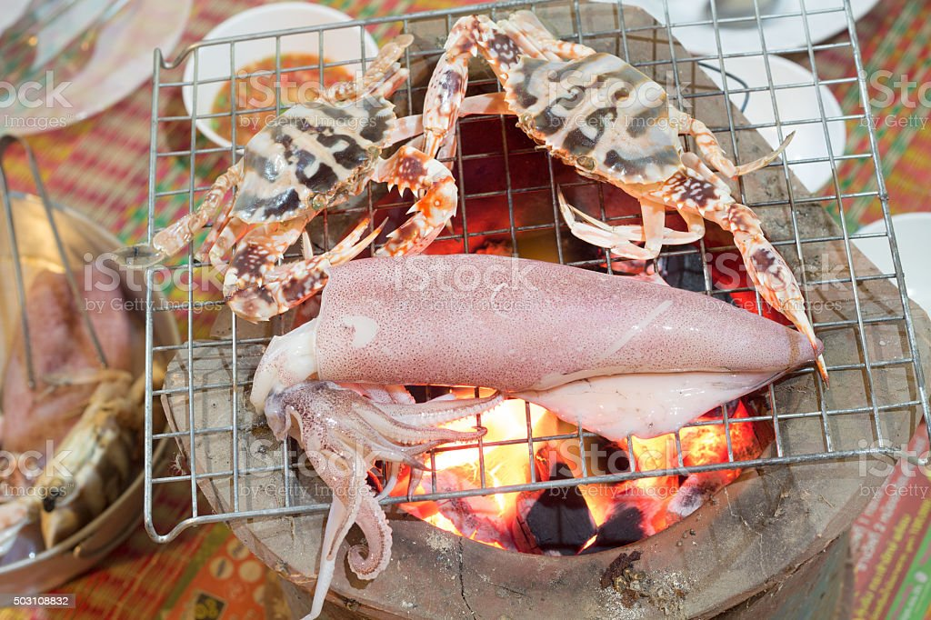 Close up fresh squid and horse crab   grilled on charcoa stock photo