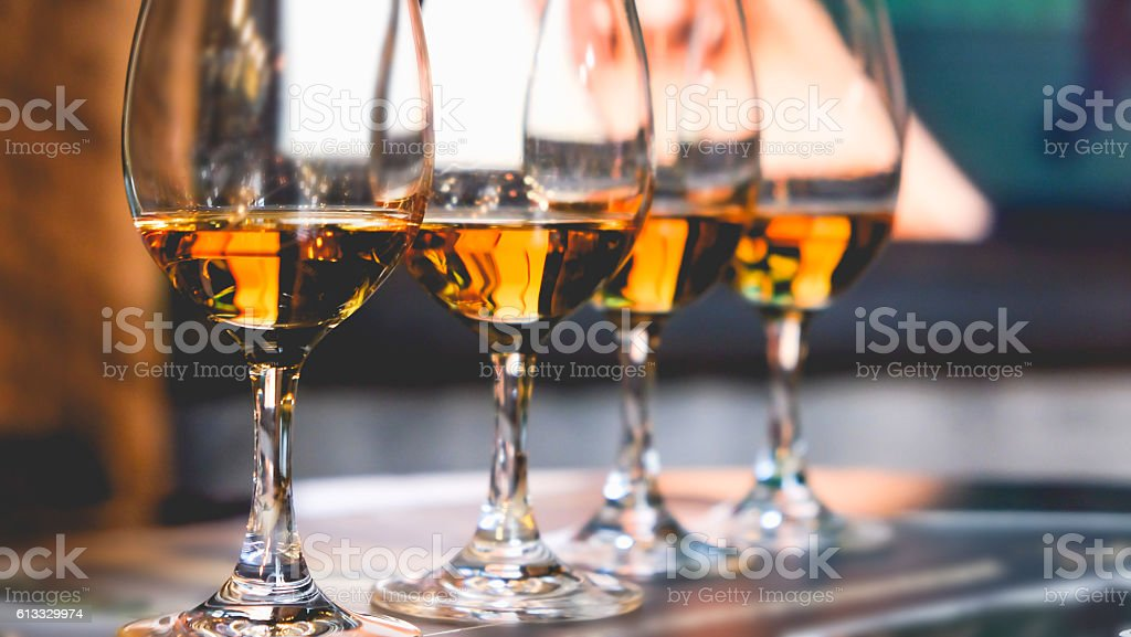 Close up glass of whiskey in a row stock photo