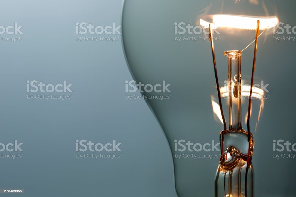 Close up glowing light bulb stock photo