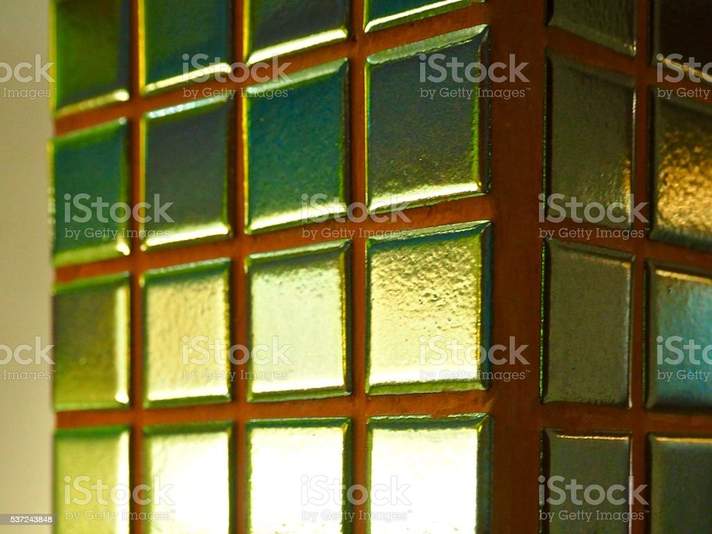 Close up: gold color mosaic tile on the column stock photo