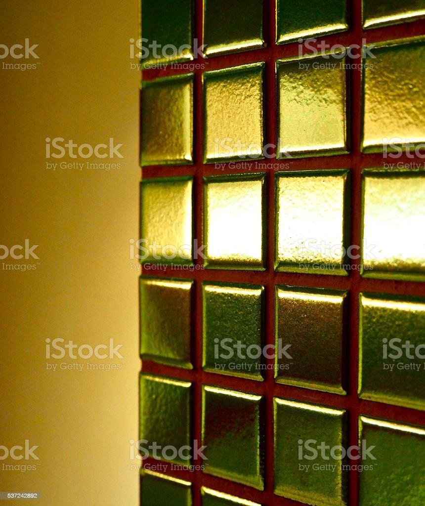 Close up: gold color mosaic tile stock photo