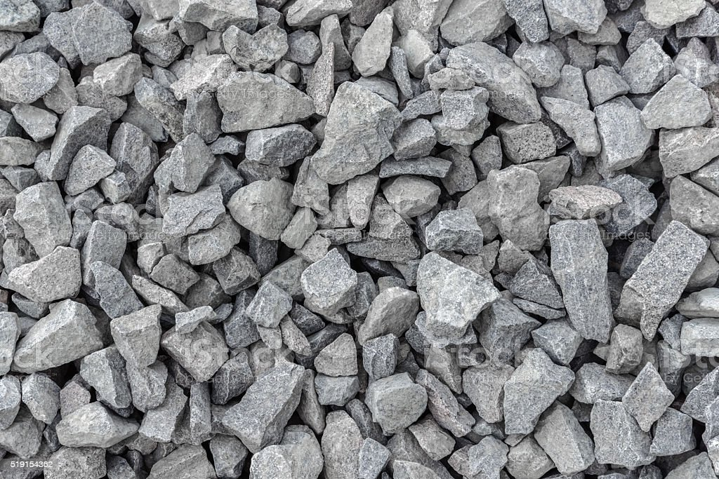 Close up gray crushed stone stock photo