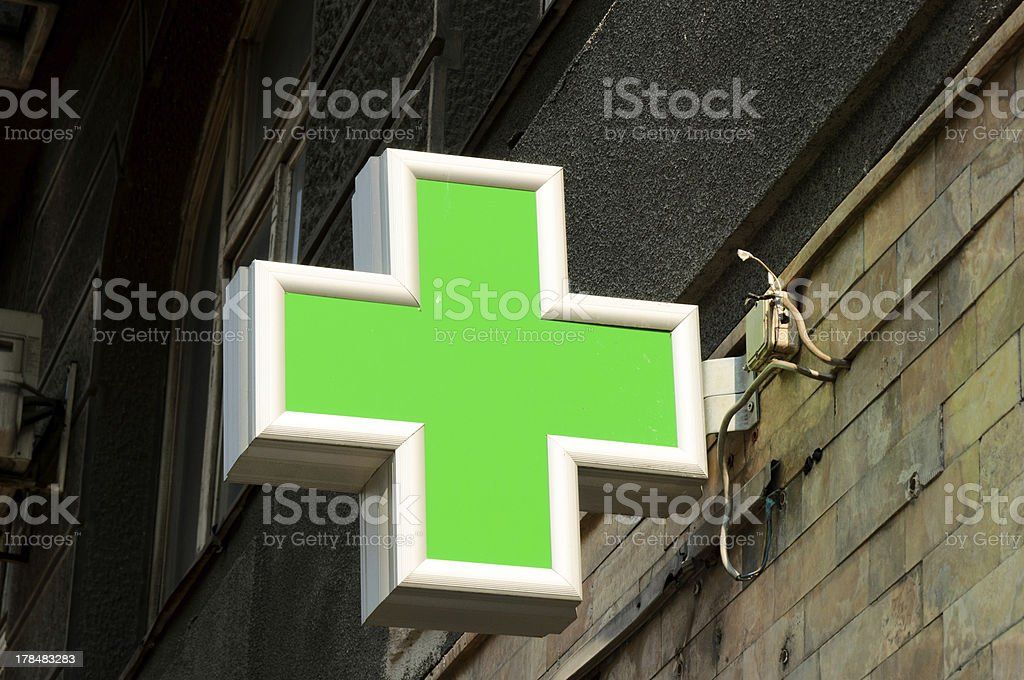 Close up green pharmacy cross sign stock photo