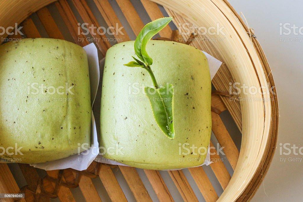 Close up green tea buns in bamboo basket stock photo