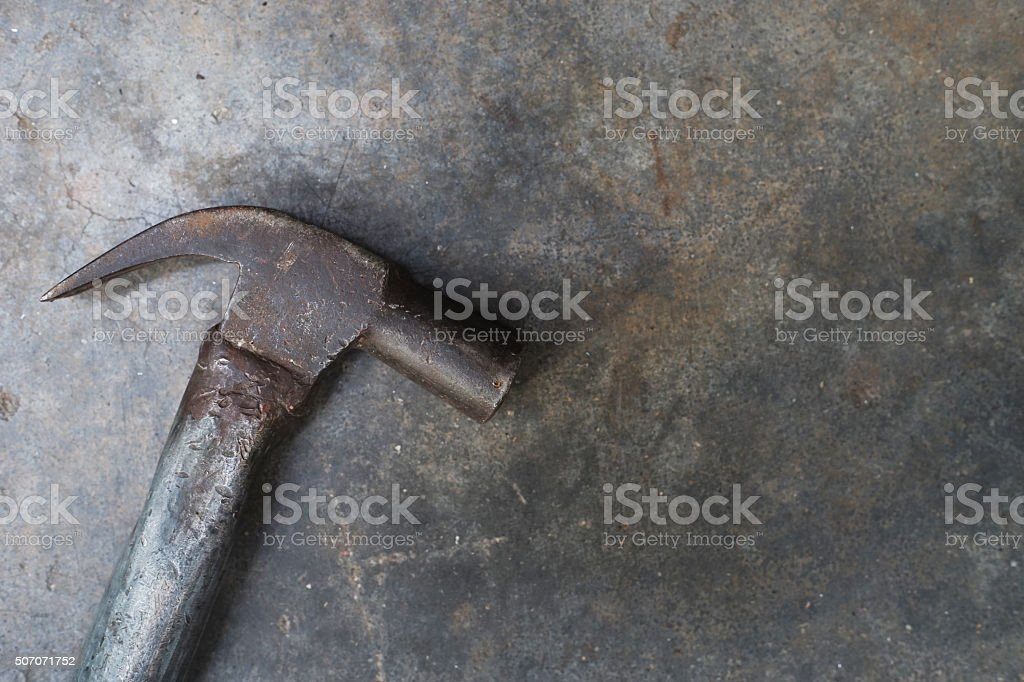 close up hammer on grunge cement background stock photo