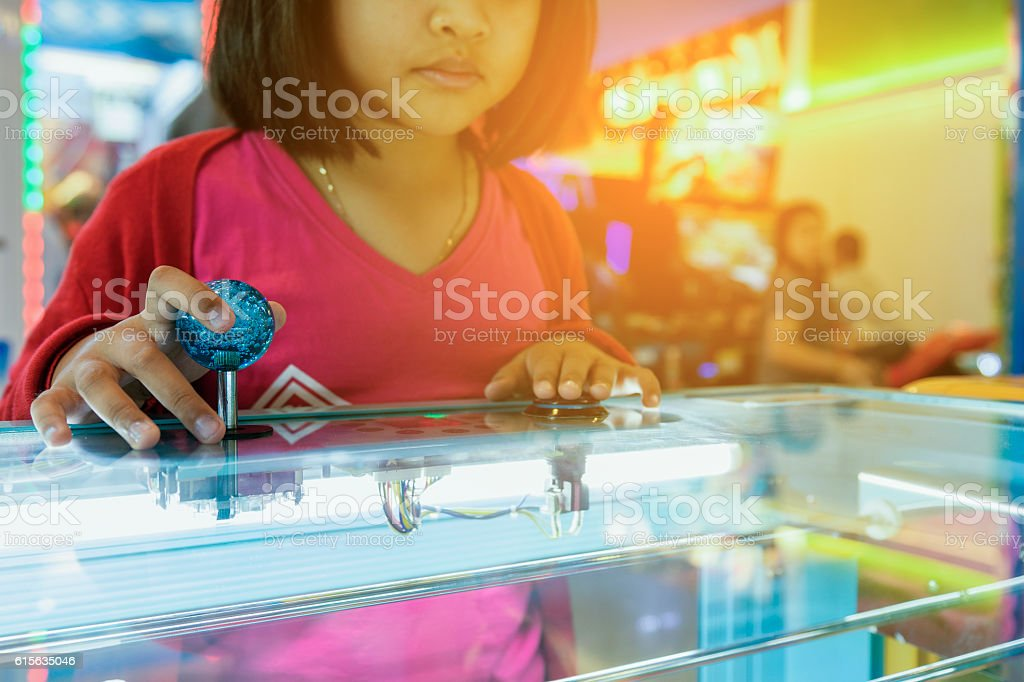 Close up hand control joystick of arcade,Vintage tone, stock photo