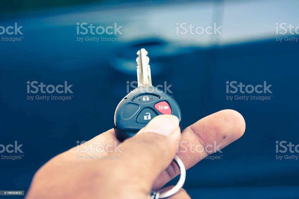 Close up Hand holding car key, Vintage tone stock photo