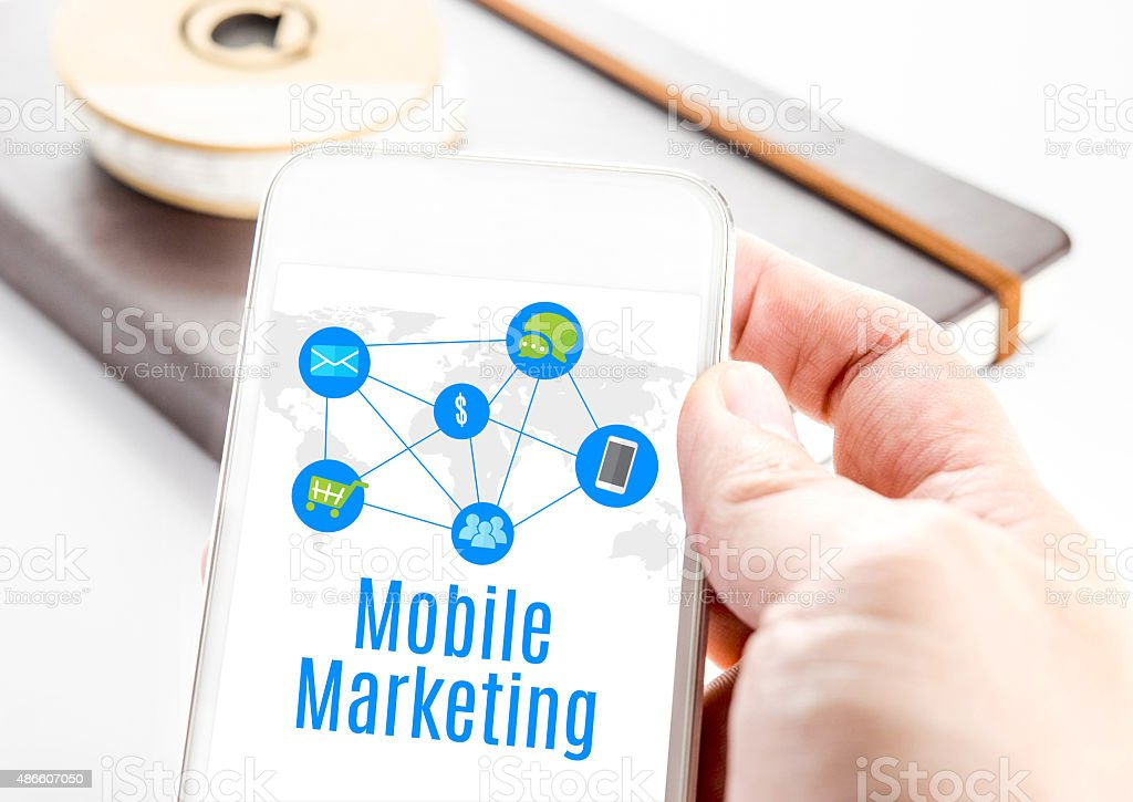 Close up hand holding smart phone with Mobile marketing stock photo
