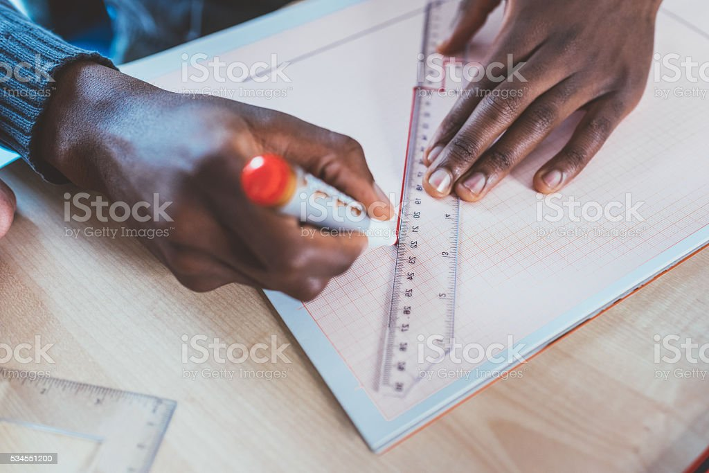 Close up hand of architect using set square and pencil stock photo
