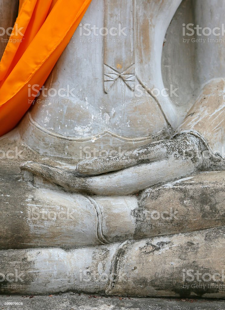 Close up hands of buddha statue stock photo