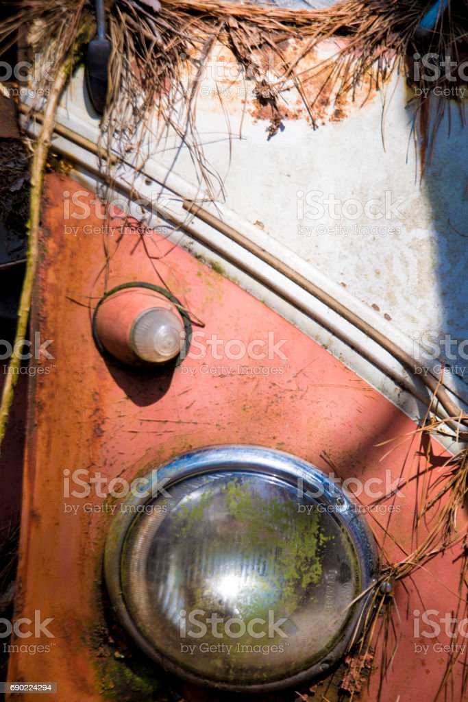 Close up headlight of old abandoned bus. stock photo