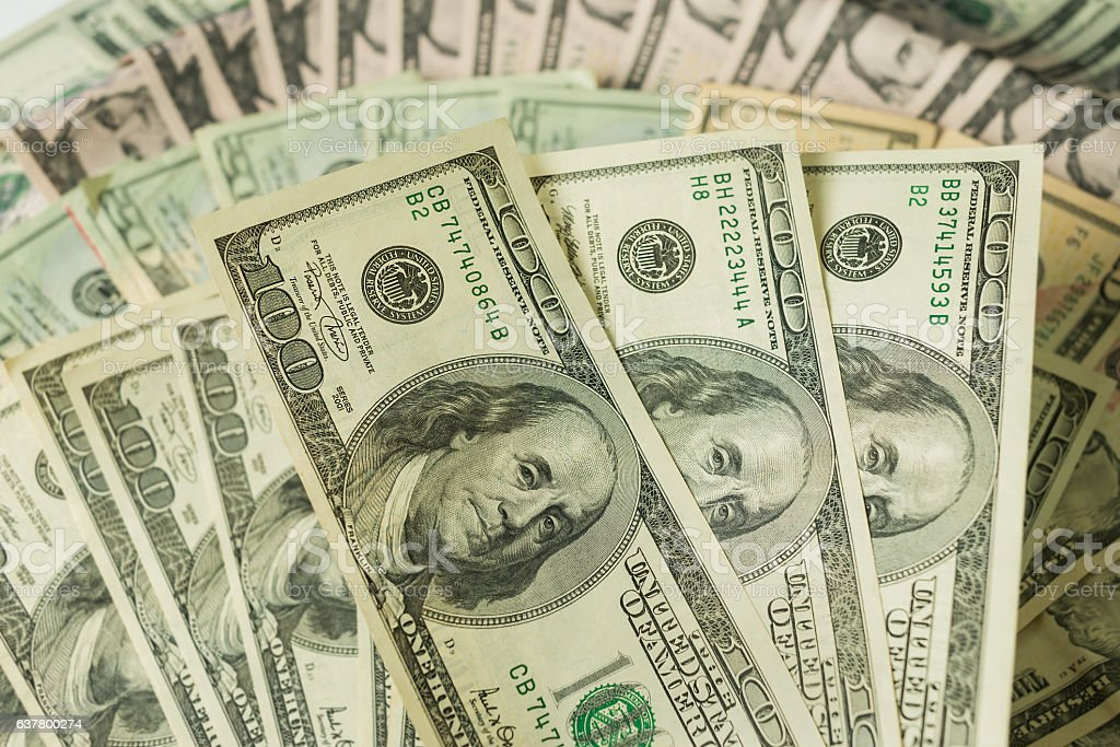 Close up heap of dollars background stock photo