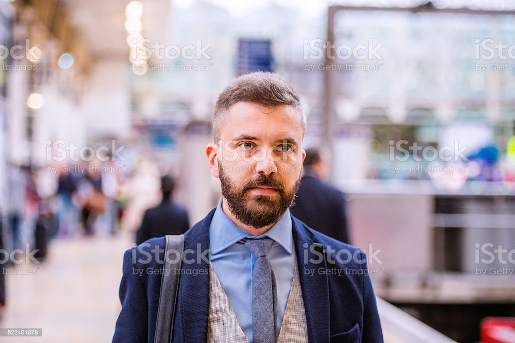 Close up, hipster businessman waiting at the train station stock photo
