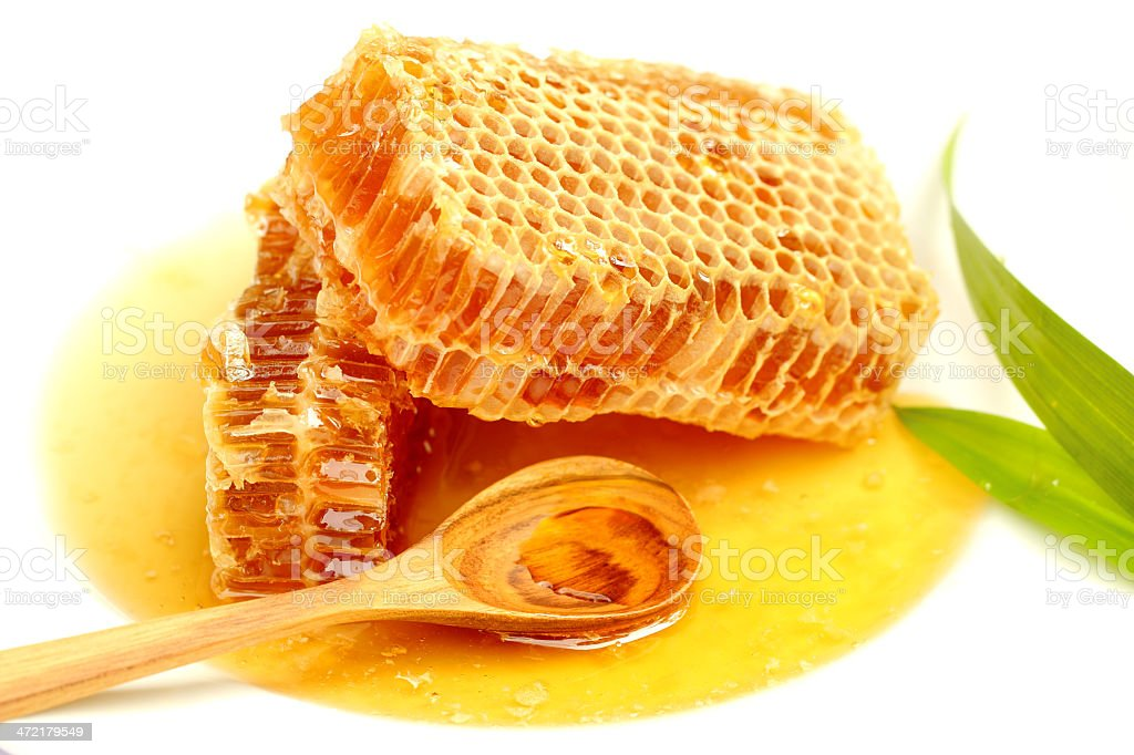 Close up honeycombs on white background. royalty-free stock photo