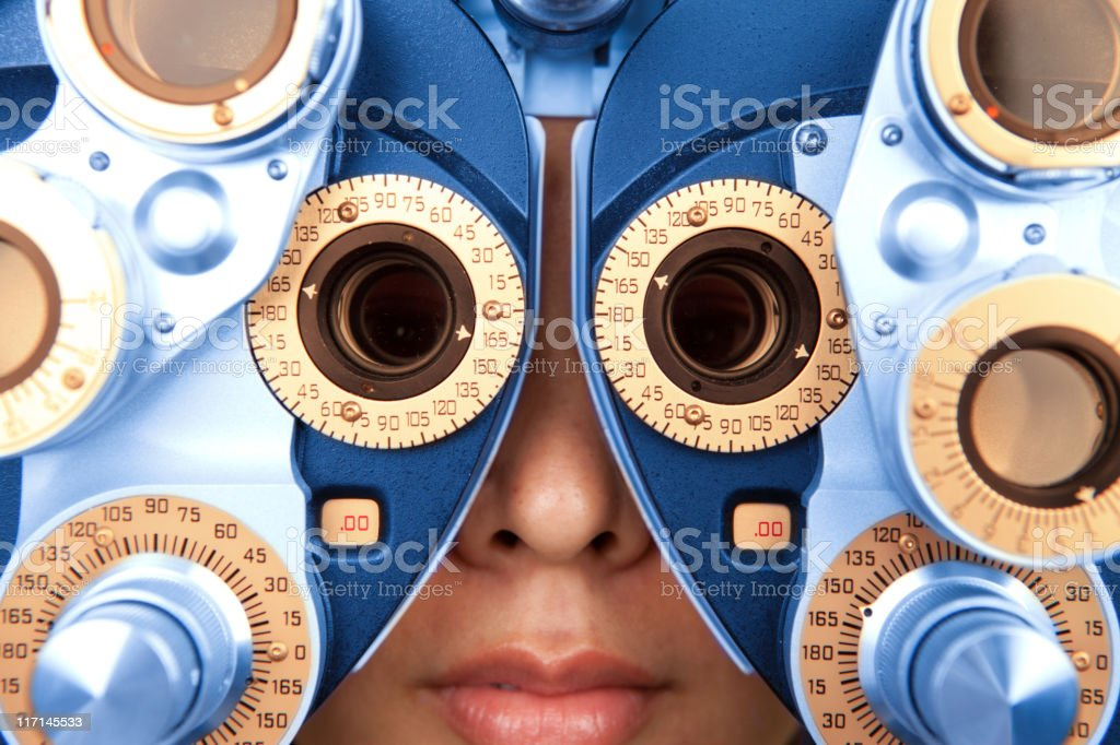 close up horizontal of optometry machine blue and orange royalty-free stock photo