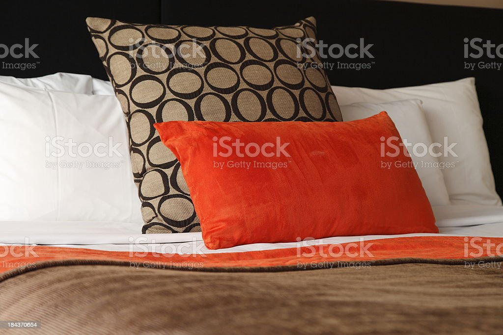 Close up hotel bed with red pillow  royalty-free stock photo
