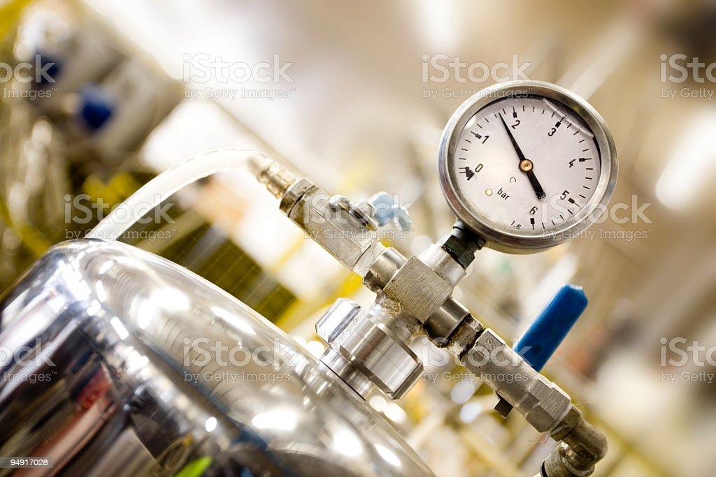 A close up image of a pressure gauge in a factory royalty-free stock photo