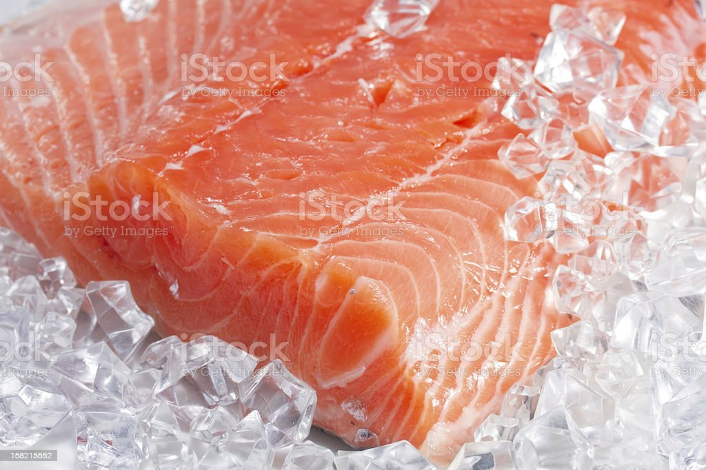 Close up image of a salmon fillet on cubed ice stock photo