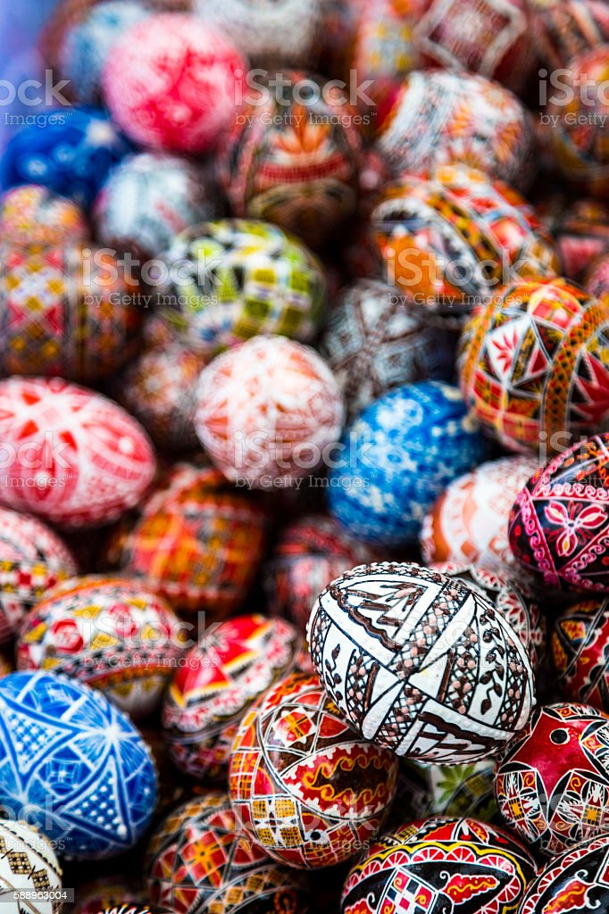Close up image of collection of colourful hand painted eggs stock photo